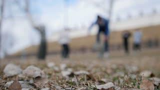 Street acrobatic in park - friendsStreet acrobatic in park - friends kids performing flips and somersaults in autumn park - de-focused kids performing flips and fints in autumn park - de-focused
