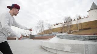 Street acrobatics - teenager jumps a flip in the park, parkour, slow motion