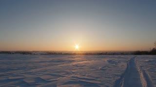 Sunrise over winter snow-covered village
