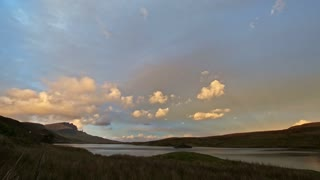 Sunset in mountains - Old Man Storr and lake in Scotland, time-lapse