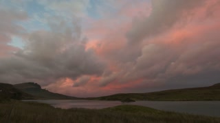 Sunset over mountain Old Man Storr over lake in Scotland, time-lapse