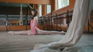 Teen sport - young pretty woman acrobatic performs flexibility - split