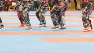 Teenager dance group at the karate tornament