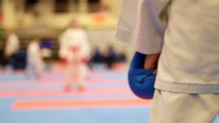 Teenager girls starts to fighting at the karate championship