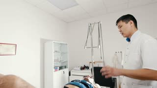 The asian doctor chiropractor conducts the procedure of stretching the back, chiropractic, Asian Tibetan medicine