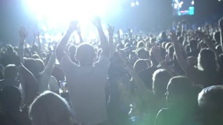 The crowd of shadows of people dancing at the concert, slow-motion