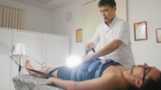 The doctor conducts the procedure, stretching the spine, chiropractic, Asian Tibetan medicine