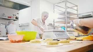 The employees of the bakery work