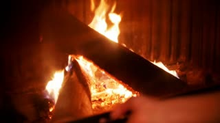 The fireplace burns. A cozy evening in a jazz bar.