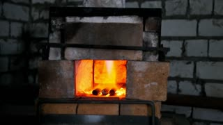The furnace of a blacksmith engulfed in flames