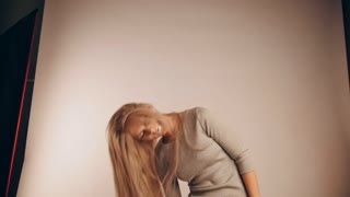 The girl model with flowing hair in photo studio, slow motion