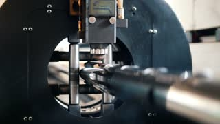 The machine saws metal sparks fly from laser