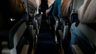The passengers on the plane ready for take off