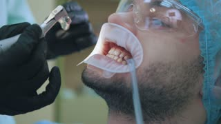 The patient man on dentist's treatment