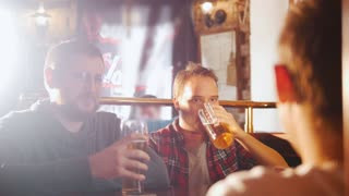 Three young men sitting in the irish pub drinking beer