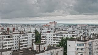 Time Lapse - city clouds over poor living districts
