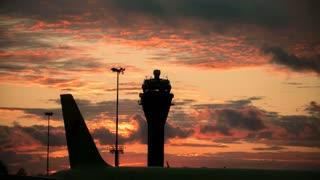 Timelapse view of International airport at sunset - control tower
