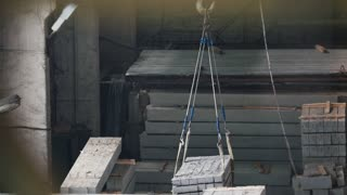 Transfer of concrete blocks to the other end of the industrial production hall