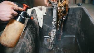 Washing of engine parts, water pressure