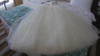 Wedding white dress on bed