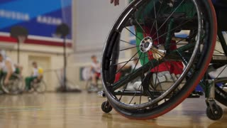 Wheel of handicapped basketball player in a wheelchair during sportive training
