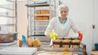 Woman bakes bread on commercial kitchen