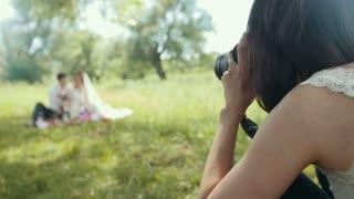 Woman wedding photographer - photo-session during wedding ceremony