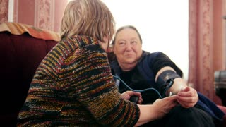 Women pensioners - checking health state with manometer - measures pressure, pensioners healthcare