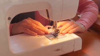Women sewing with sewing machine - close up