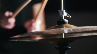 Women's hands holding sticks and beat the drums
