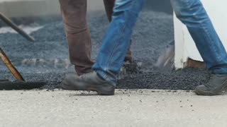 Workers are creating new asphalt - road construction in city