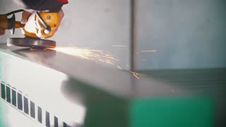 Worker's hand is grinding the steel mechanism on industry, slow-motion
