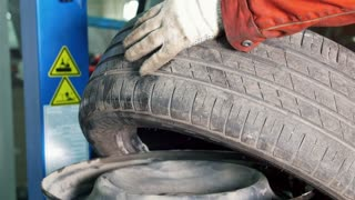 Working for repairing the tires - mechanical workshop