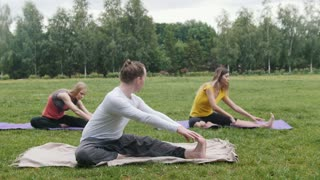 Yoga training outside in park - flexibility