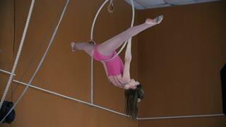 Young girl acrobats with a gymnastic hoop