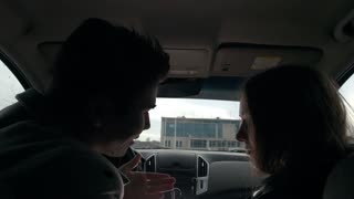 Young man and woman quarrel in the car