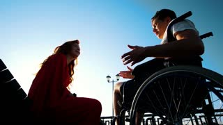 Young Man Plays The Piano For A Red Girl In A Wheelchair
