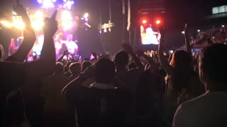 Young people dancing at the rep rock concert, slow-motion