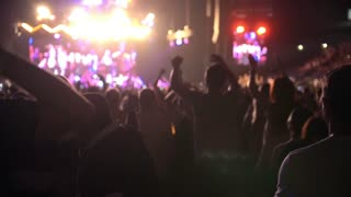 Young people is dancing at the rep rock concert, slow-motion