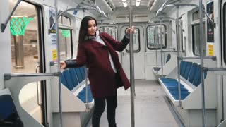 Young woman dancing in subway
