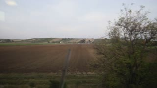 View from a train window - autumn meadow in Europe