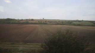 View from a train window - European Autumn fields meadows