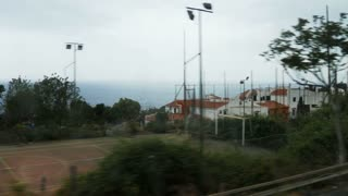 View of the Italian marine landscape from the train window (in motion).