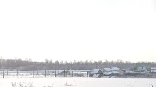 View of typical Russian village at winter - countryside in center of Volga, snow cold day, panoramic