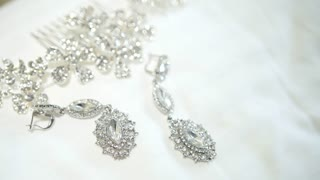 Wedding accessories on the white surface