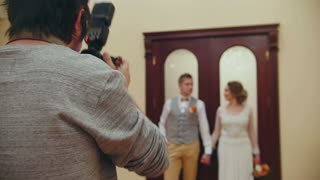 Wedding photographer - young married couple indoor