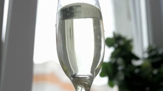 wedding ring drops in a glass of champagne