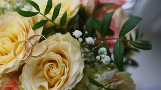 Wedding rings on flowers - changing light