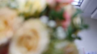 Wedding rings on flowers - rack focus