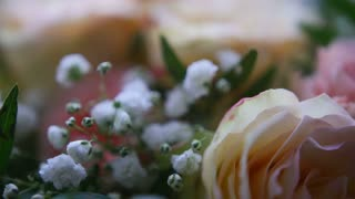 Wedding rings on flowers - slider move